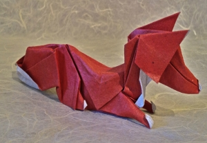 fox by layers of paper